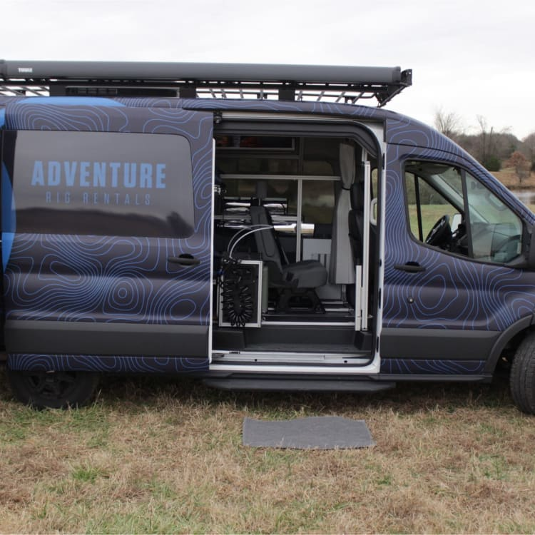 Seating for 4 is the standard layout. The hot water on demand system can be moved around inside the van, or brought outside for a hot shower in the wild!
