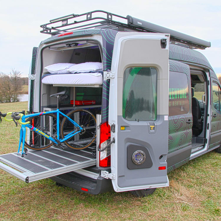 Large roof rack for gear. Extending gear slide for easy packing and accessing. That slide can also be used as a bed. Telescoping queen bed goes up and down depending on whether you need more sleep space or gear space.