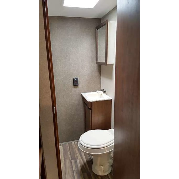 """Fantastic little bathroom with separate toilet and shower.  Medicine cabinet includes a first aid kit for all those """"uh ohs"""" on the go."""