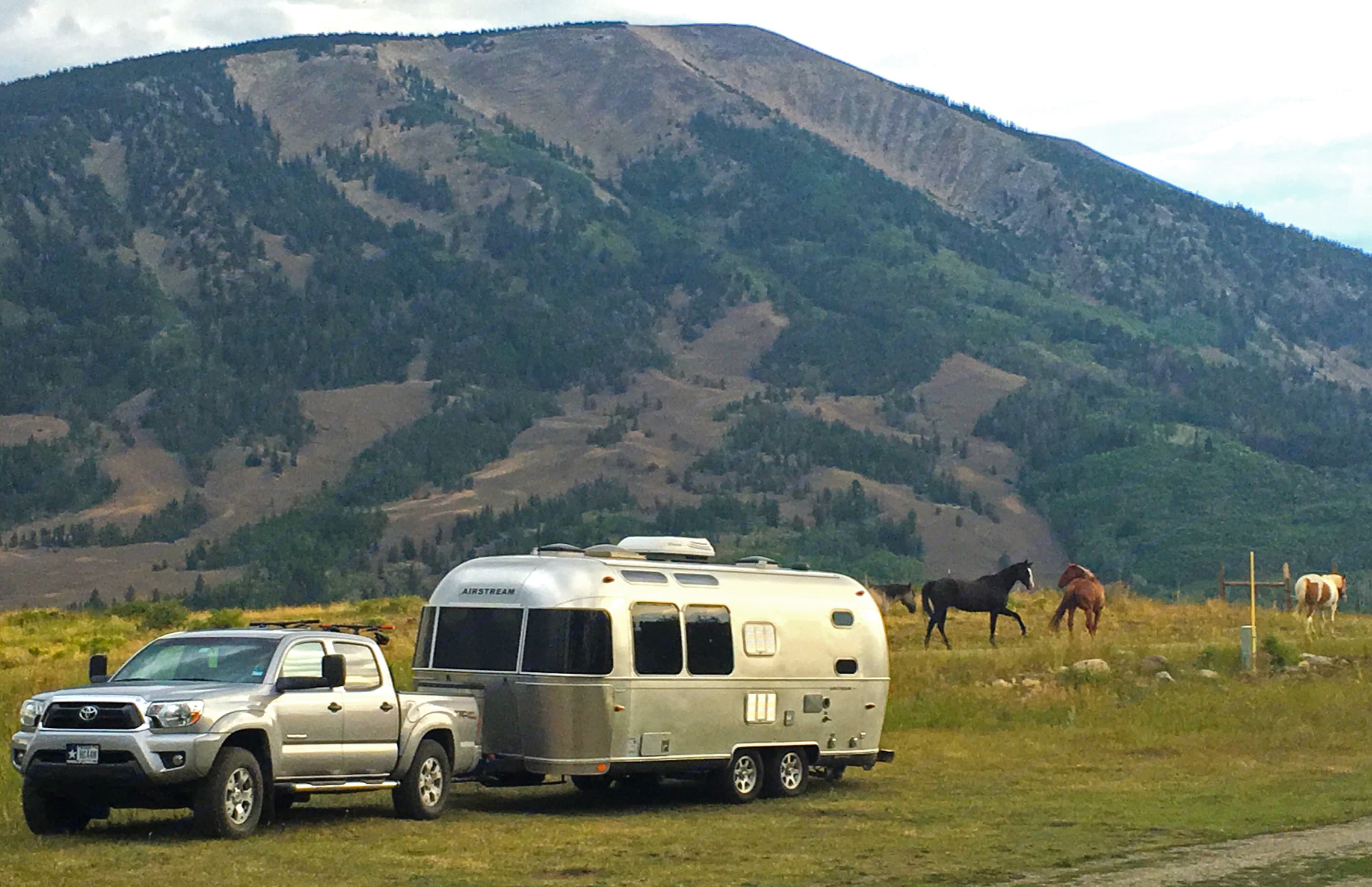 Along side a horse ranch in Wyoming. Our awesome clients pulled over to take this beautiful scene to share with us. . Airstream Flying Cloud 2014