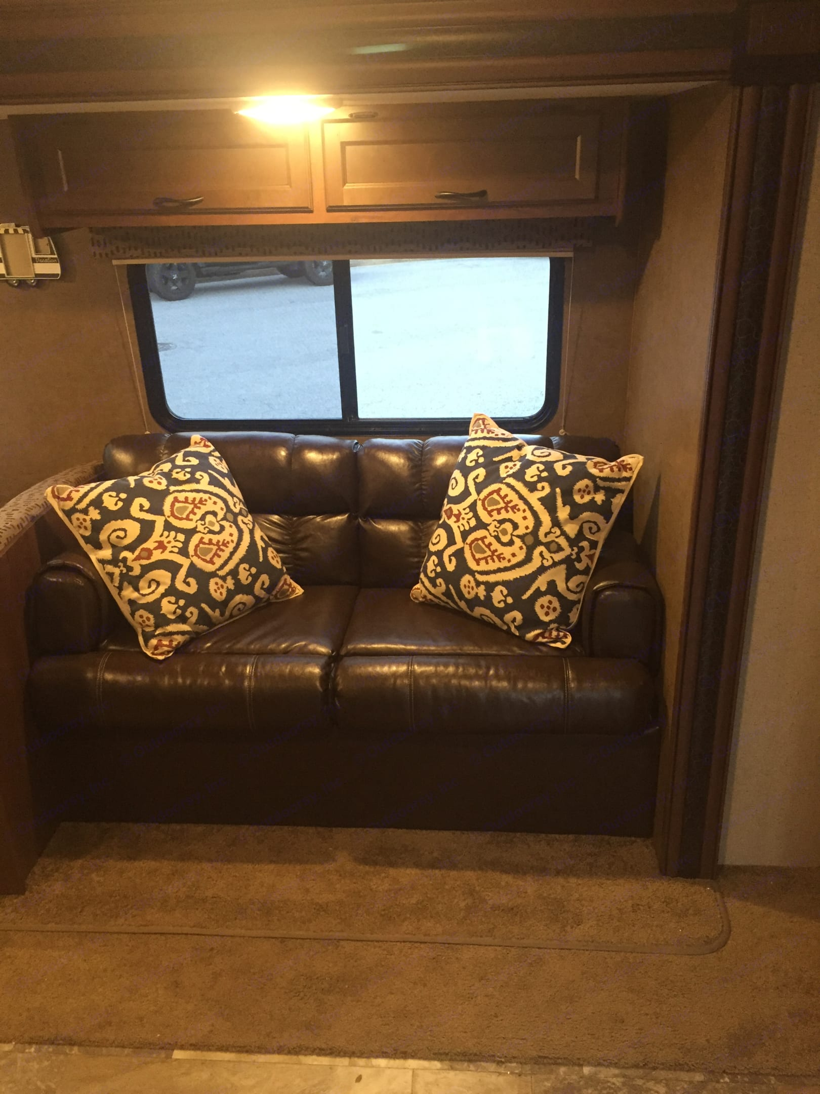 Leather couch folds down to double bed. Jayco Jay Flight 2015