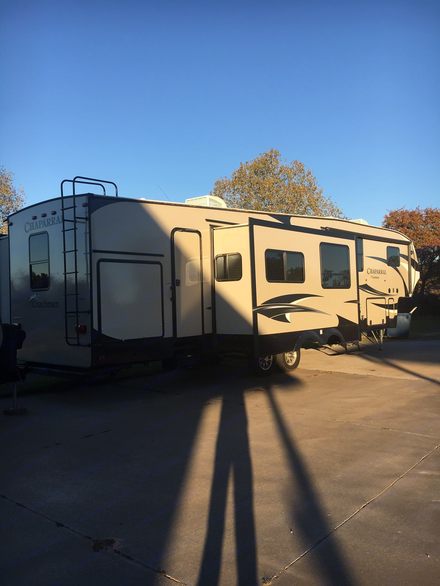 Two entry doors and also has an outdoor kitchen with second refrigerator and sink.. Coachmen Chaparral 2016