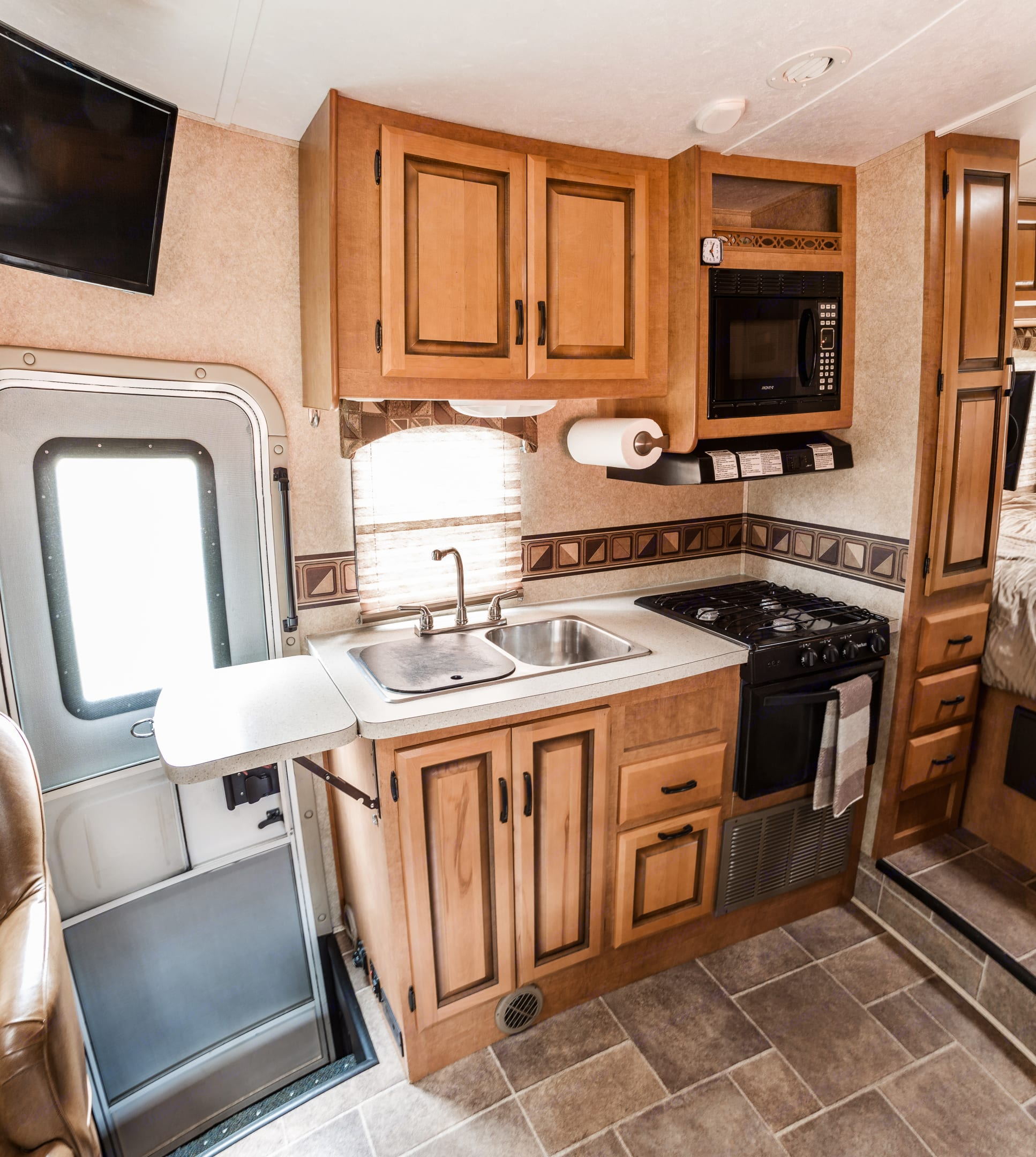 Kitchen area, all cooking necessities and plates provided Microwave, Stove, Oven, inline water filtration system, bathroom sink with mirror and separate kitchen sink. Forest River Sunseeker 2450s 2013