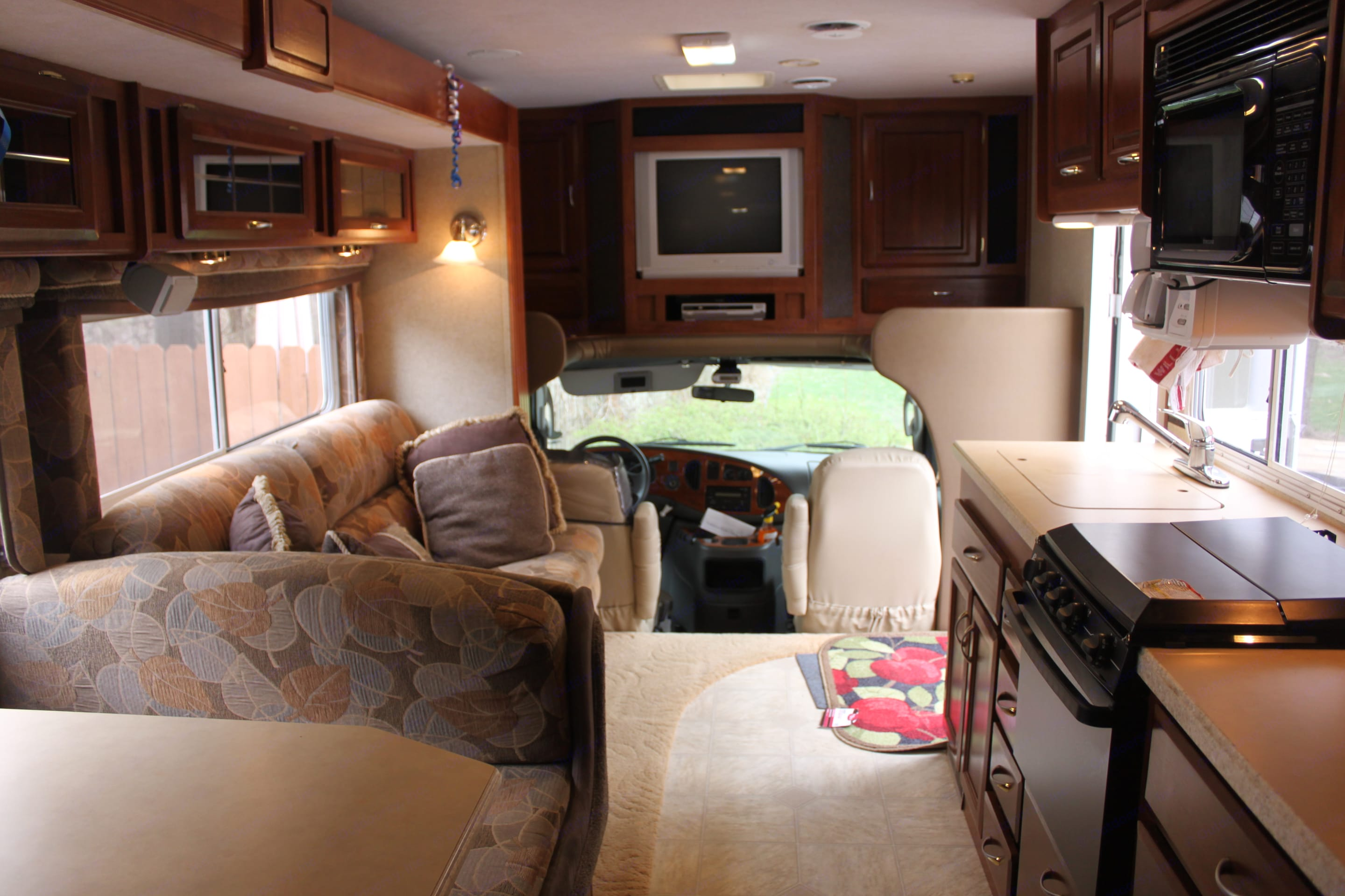 Ready for travel... interior space with the slide in. Jayco Granite Ridge 2004
