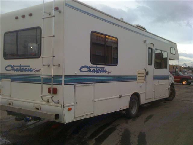 Exterior Passenger Side, Rear View. Thor Motor Coach Four Winds Chateau 1999