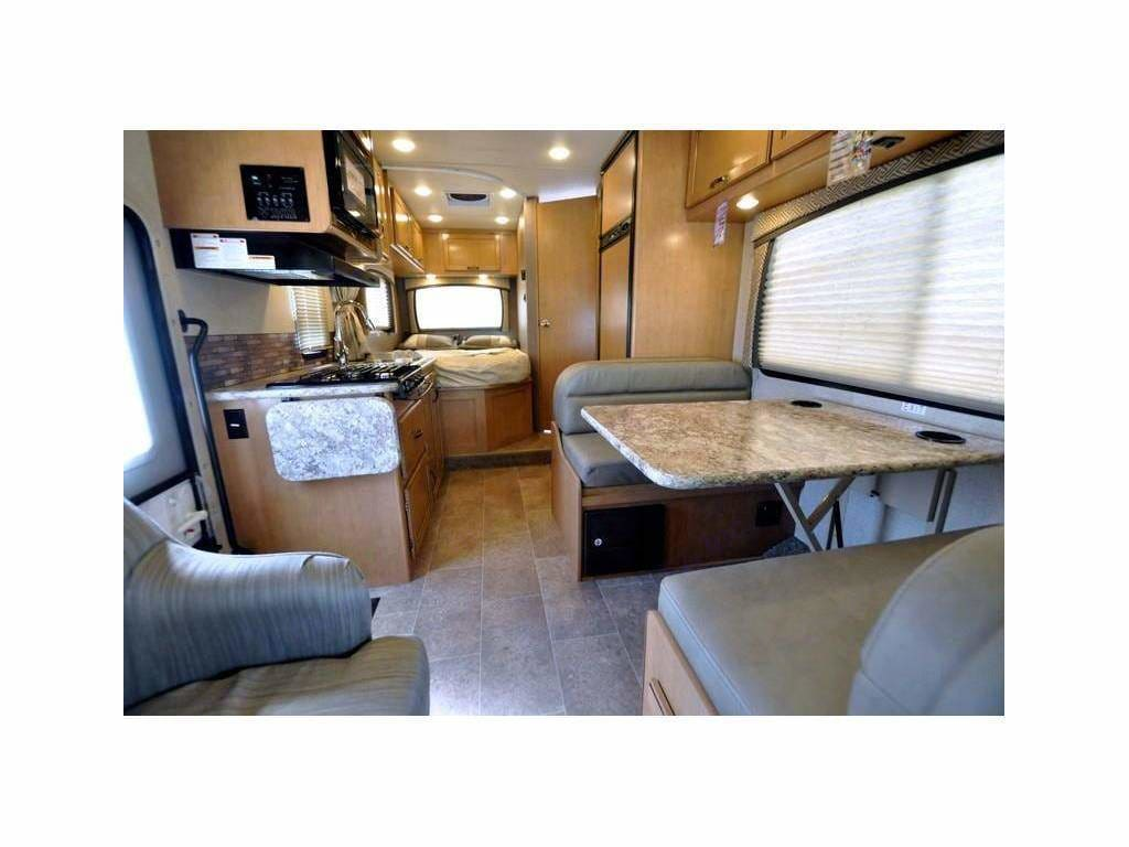 Living Room/Kitchen Area. Table Drops Down as a bed as well. Thor Motor Coach Chateau 2016