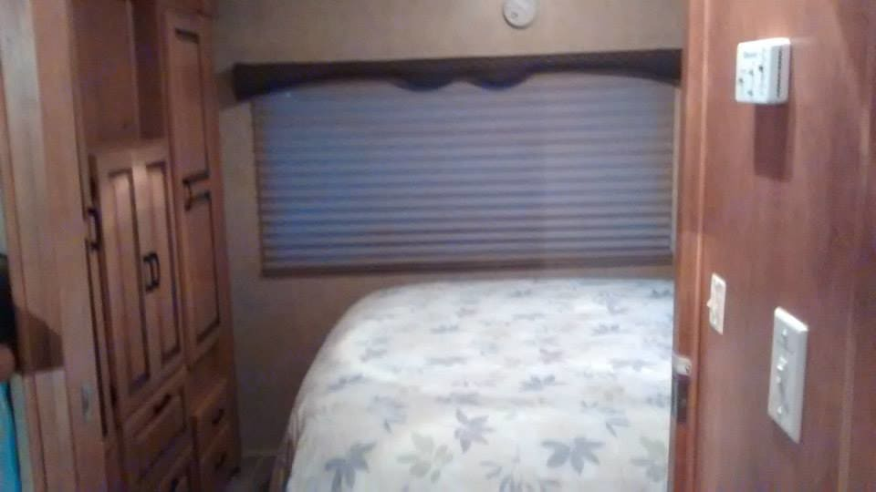 private bedroom with queen sized bed and full wardrobe . Forest River Sunseeker 2011