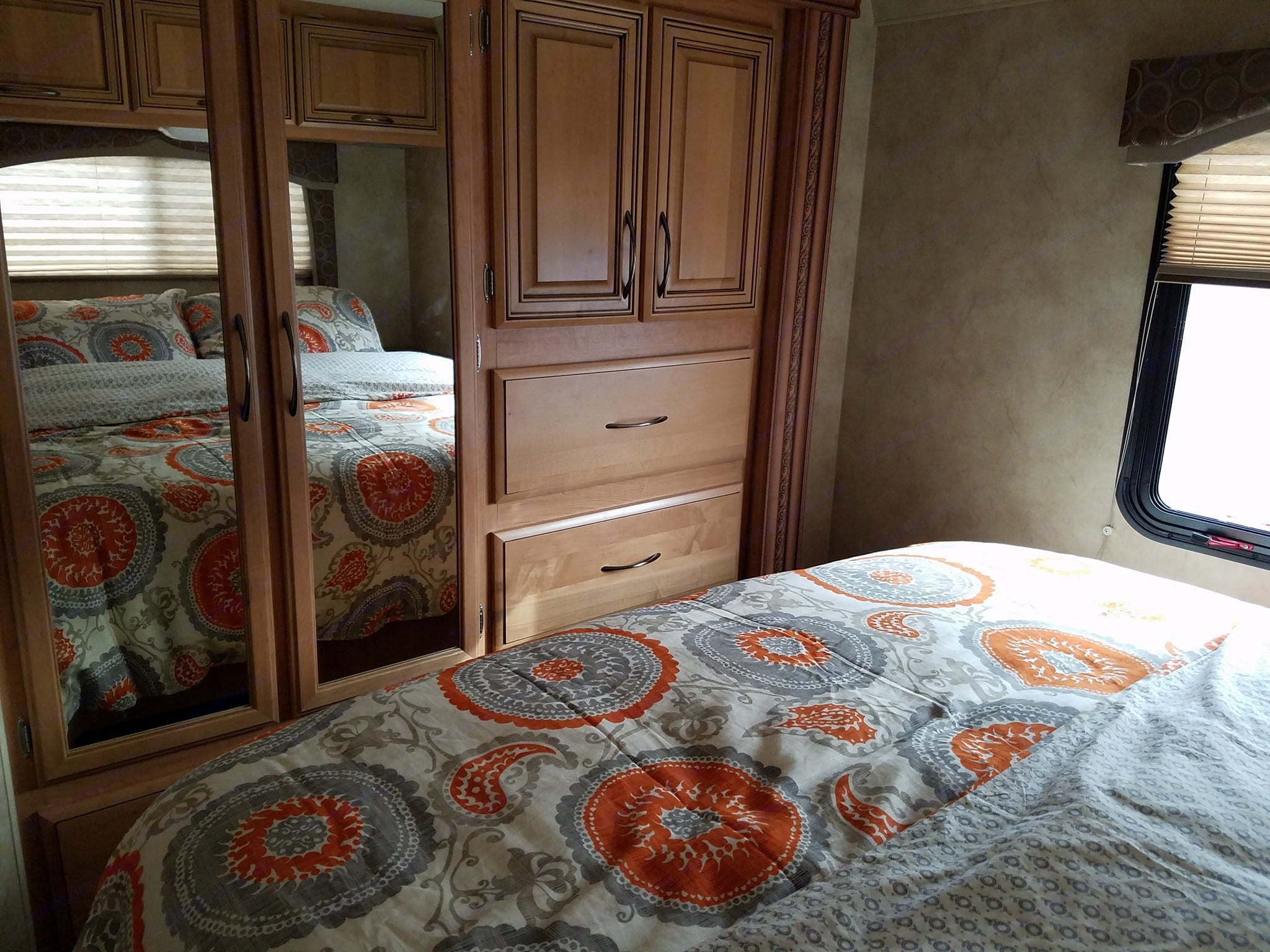 Main Bedroom with queen size bed. Can be closed off with lots of storage. Thor Motor Coach Chateau 2011