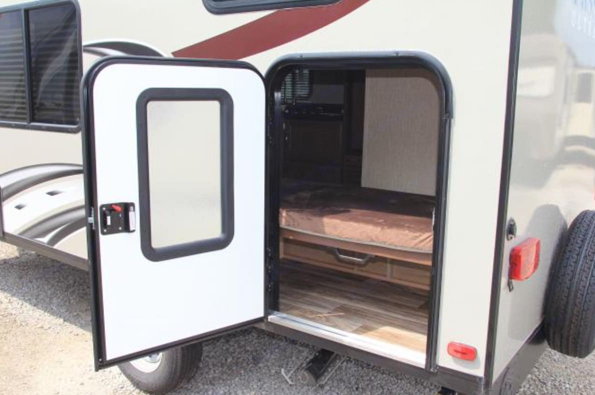 Half door and movable lower bunk make great space for hauling gear and toys. . Keystone Passport 2017
