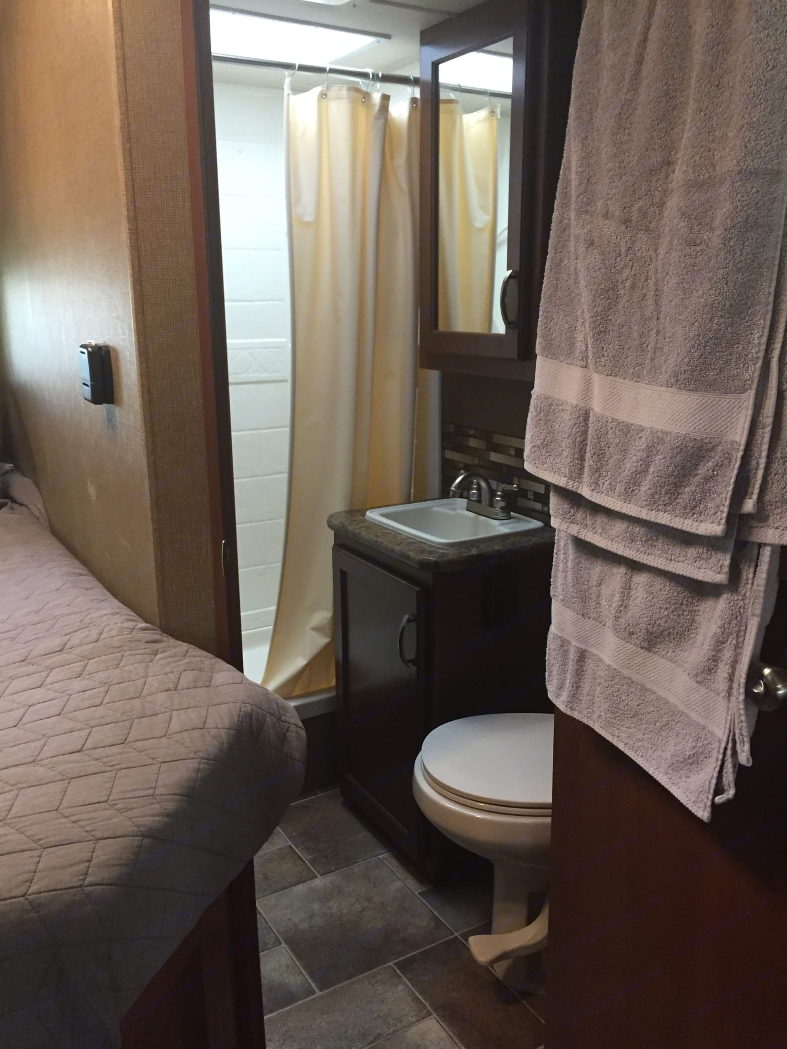 The bathroom has a shower, sink and toilet. There is a medicine cabinet and some storage under the sink. The shower has a handy shutoff switch to help make the hot water stretch.. Thor Motor Coach Chateau 2016