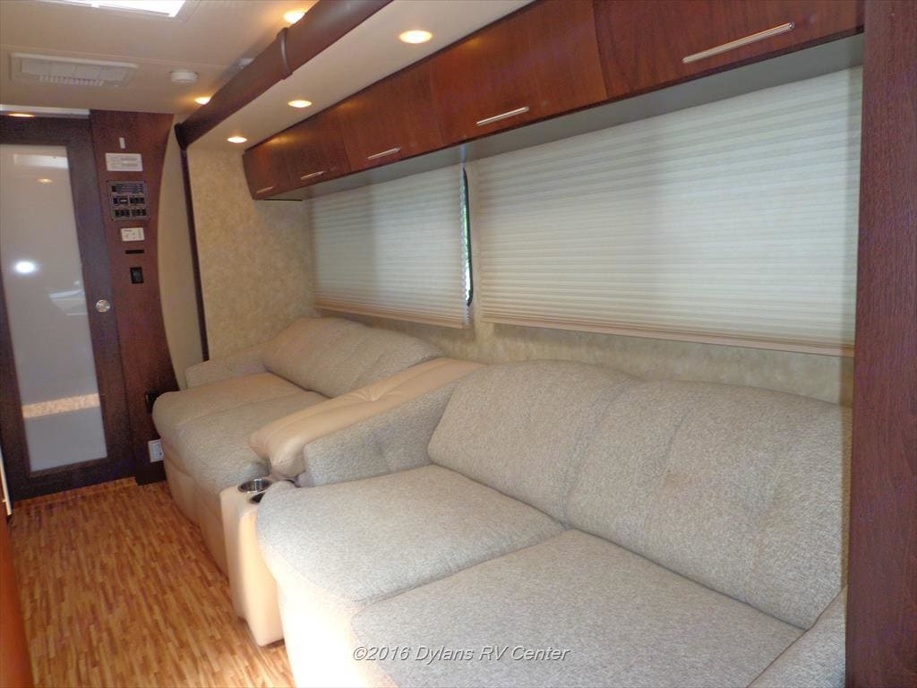 Very comfortable dual sofas. One folds out into full size bed while the other trades the dining table. . Coachmen Prism 2009