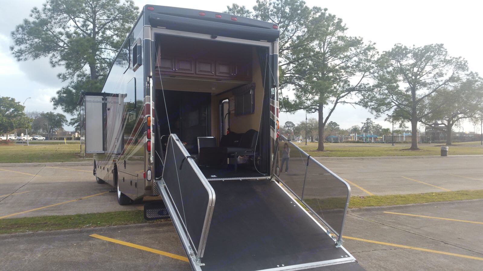 We have a little golf cart we drive right up in there. (not included)  The back gate can be used as a porch. However, we did remove those silver railings because it made getting the thing set up in either ramp or porch position only take about 30 seconds. . Thor Motor Coach Outlaw 2016