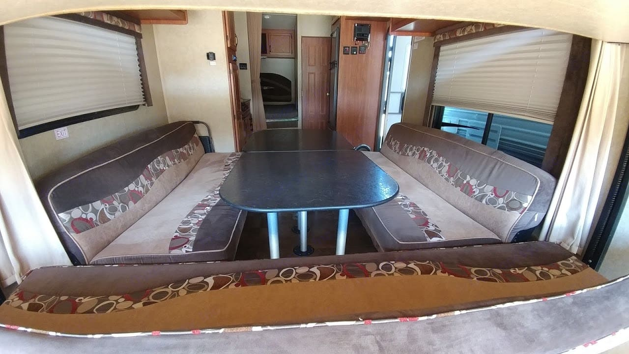 With dining table and seats set up.  Couches fold down into beds.. Jayco Octane 2014