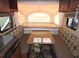 Forward pop out sleeps 2.  Table/dining configuration shown.  Converts to sleeping space for 1-2 people.. Coachmen Clipper 2015