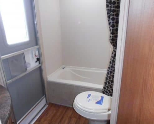 Bathroom with entrance/exit door. Salem Cruise Lite Bunk House 2015