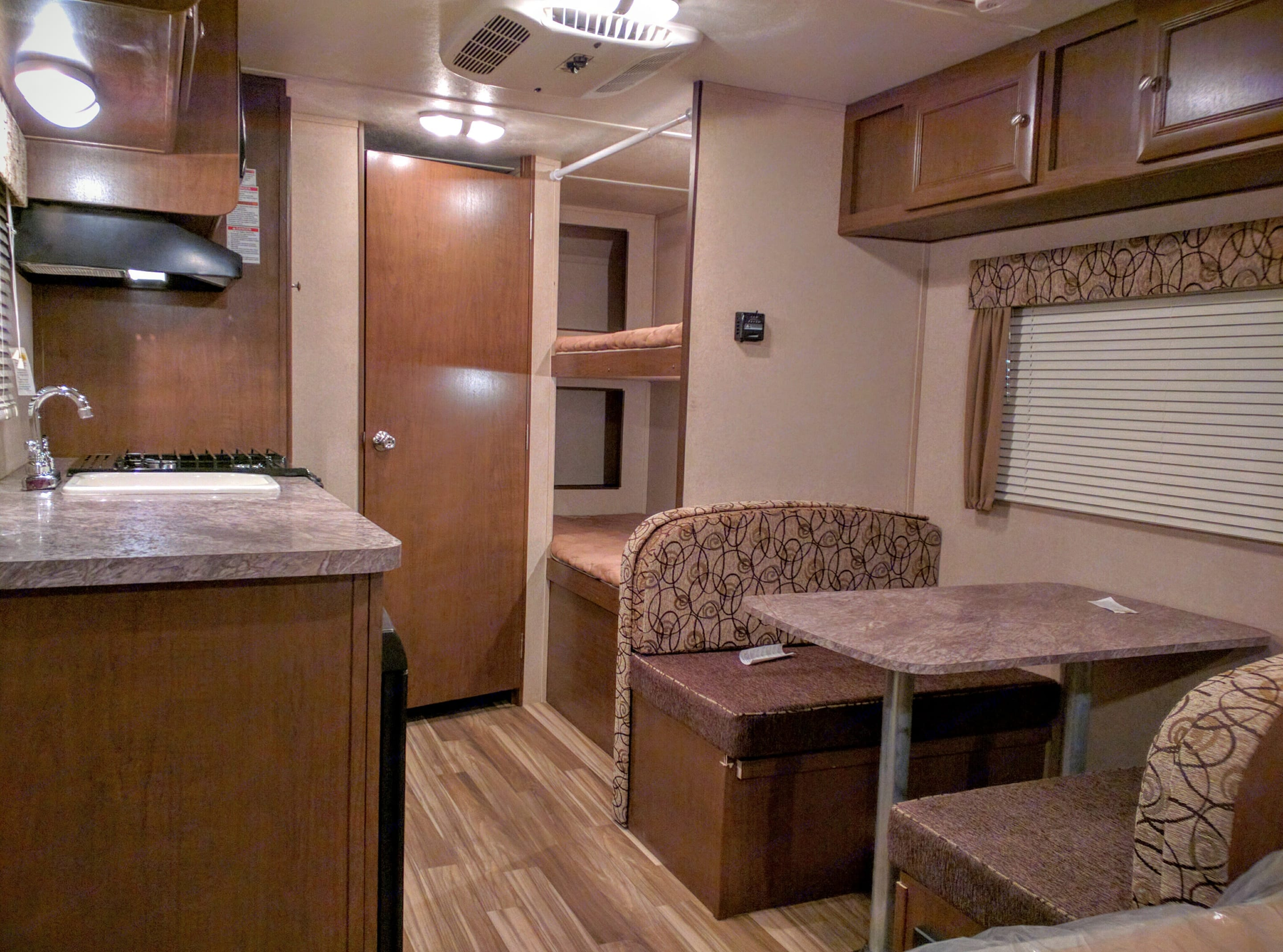 View from the entry. Dinette, bunk beds, bathroom, kitchen.. Shasta 18bh 2016