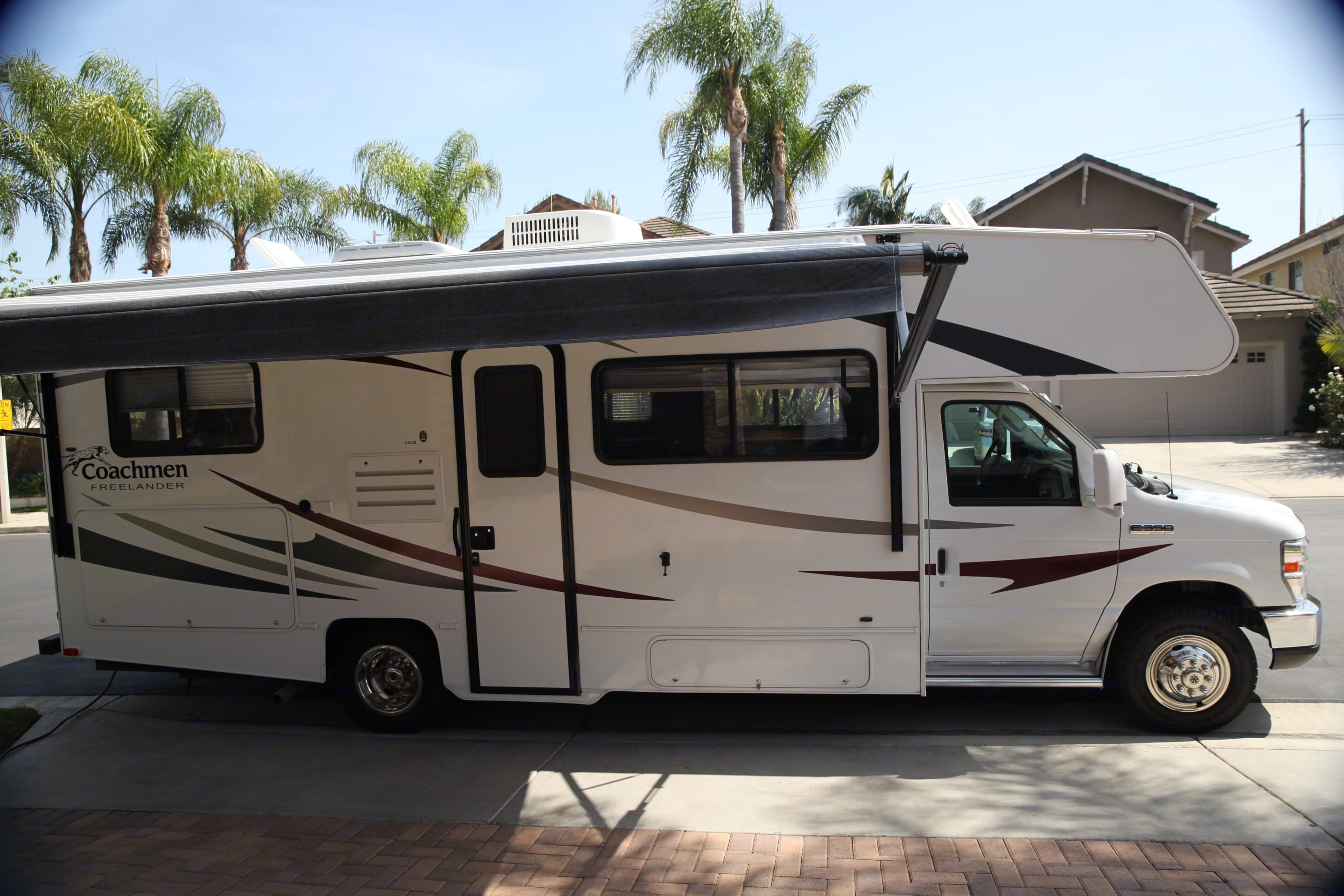 With  Automatic Awning Extended. Coachmen Freelander 2012