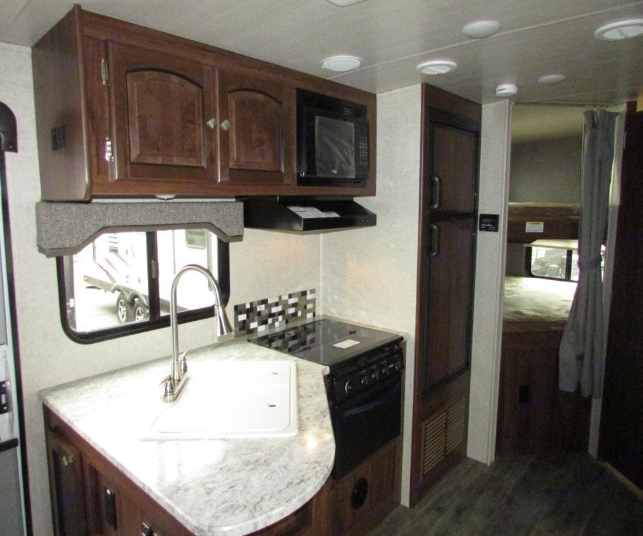 3 burner stove, oven, microwave, deep sink with pull down faucet.. Heartland North Trail 2018