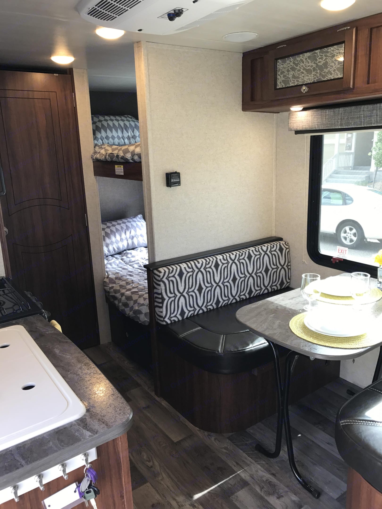 Dining table (seats 4) with bunks in back. Heartland Mallard 2018