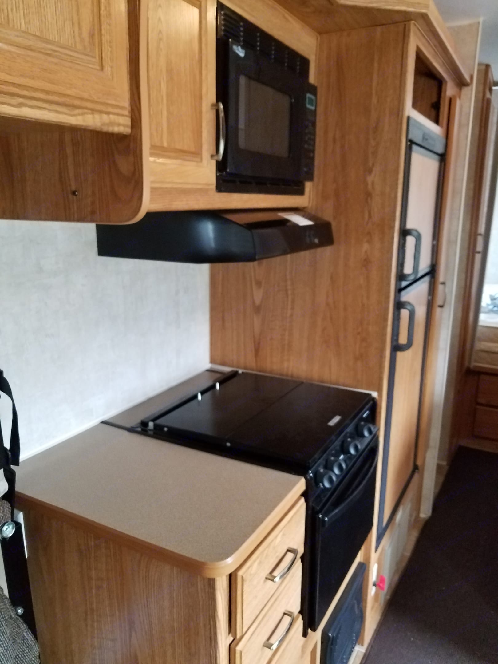 Stove and oven like new separate front bedroom in front of trailer. Other Other 2006