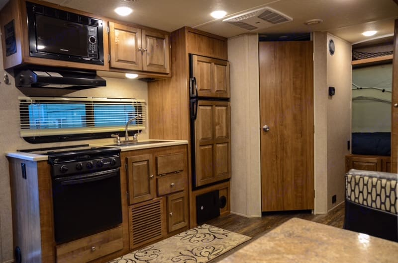 Kitchen with fridge and bathroom entrance.. Forest River Rockwood Roo 2017