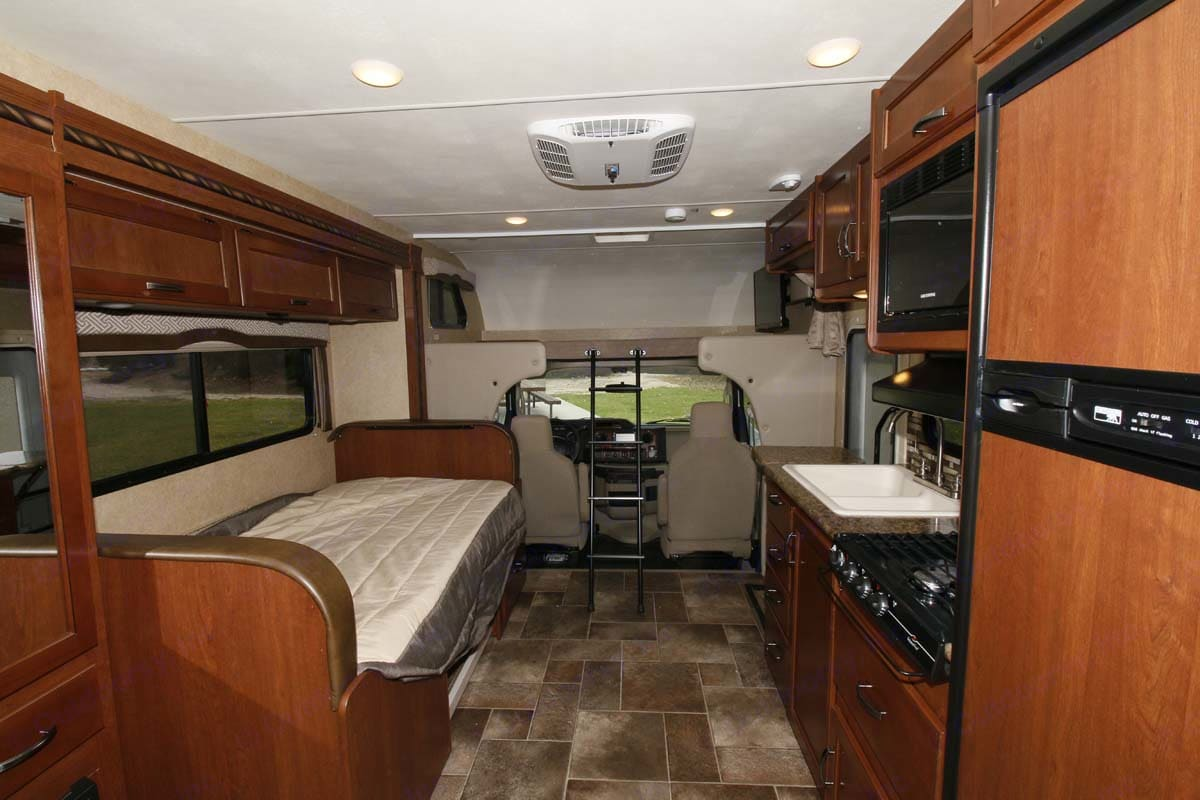 Showing dinette converted to super twin, as well as cab over bunk, which is queen size.     . Thor Motor Coach Chateau 2017