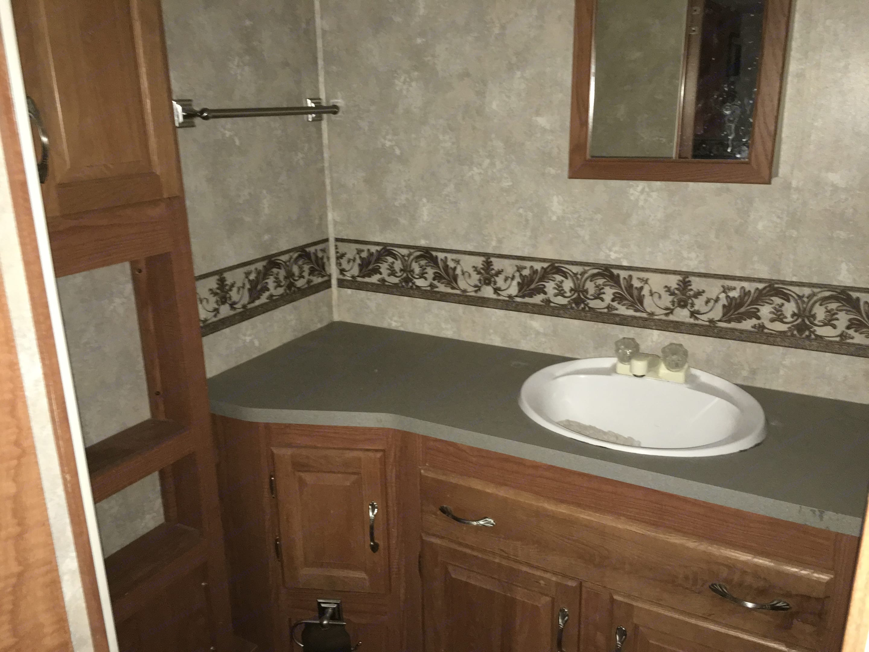 Bathroom with stand in shower.. Coachmen Chaparral 2005