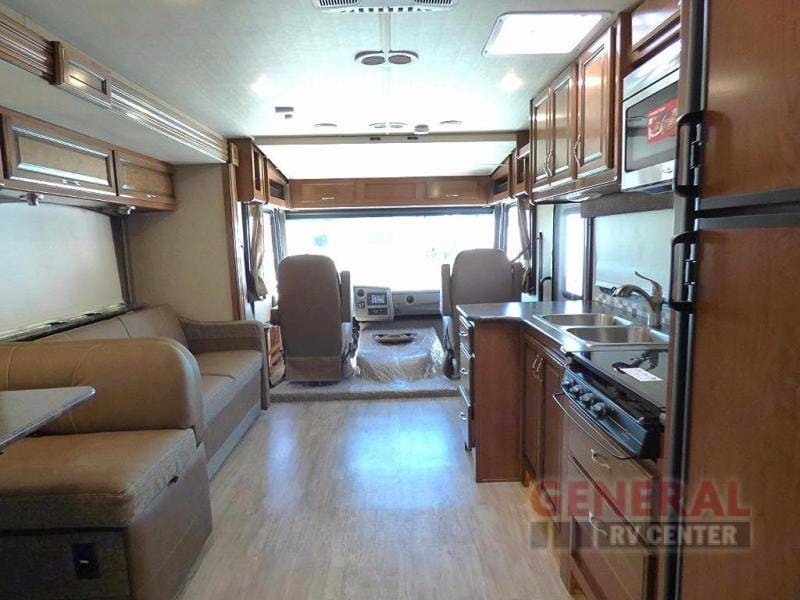 Plenty of floor room, jackknife sofa and dinette sleeper for younger campers.  Front captain chairs swivel backwards to make plenty of inside seating, front table on a stand for coffee or laptop workspace.. Fleetwood Flair 2017