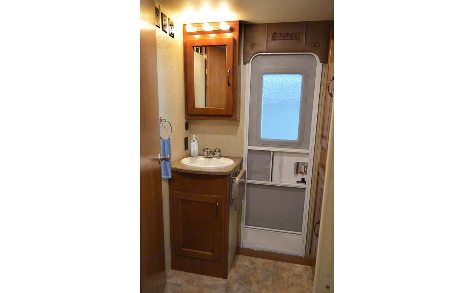 Bathroom sink separated from the bathroom by a door. Lance 2185 2015