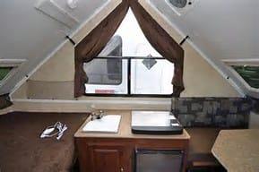 Includes sink, 3 burner stove, frig (under stove), storage (under sink.). Forest River Flagstaff Classic 2013