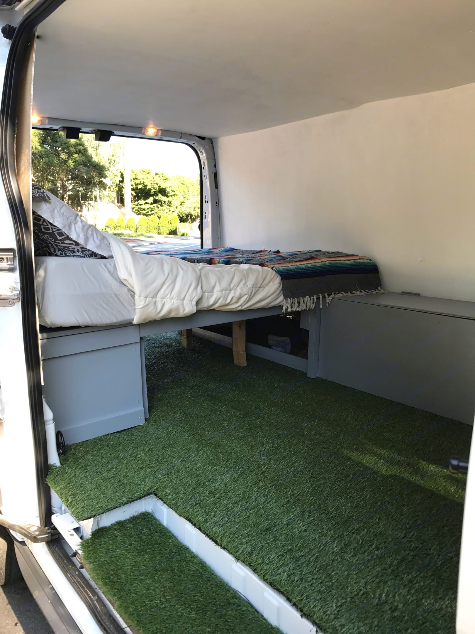who doesn't love a faux grass floor?. Ford Transit 2016
