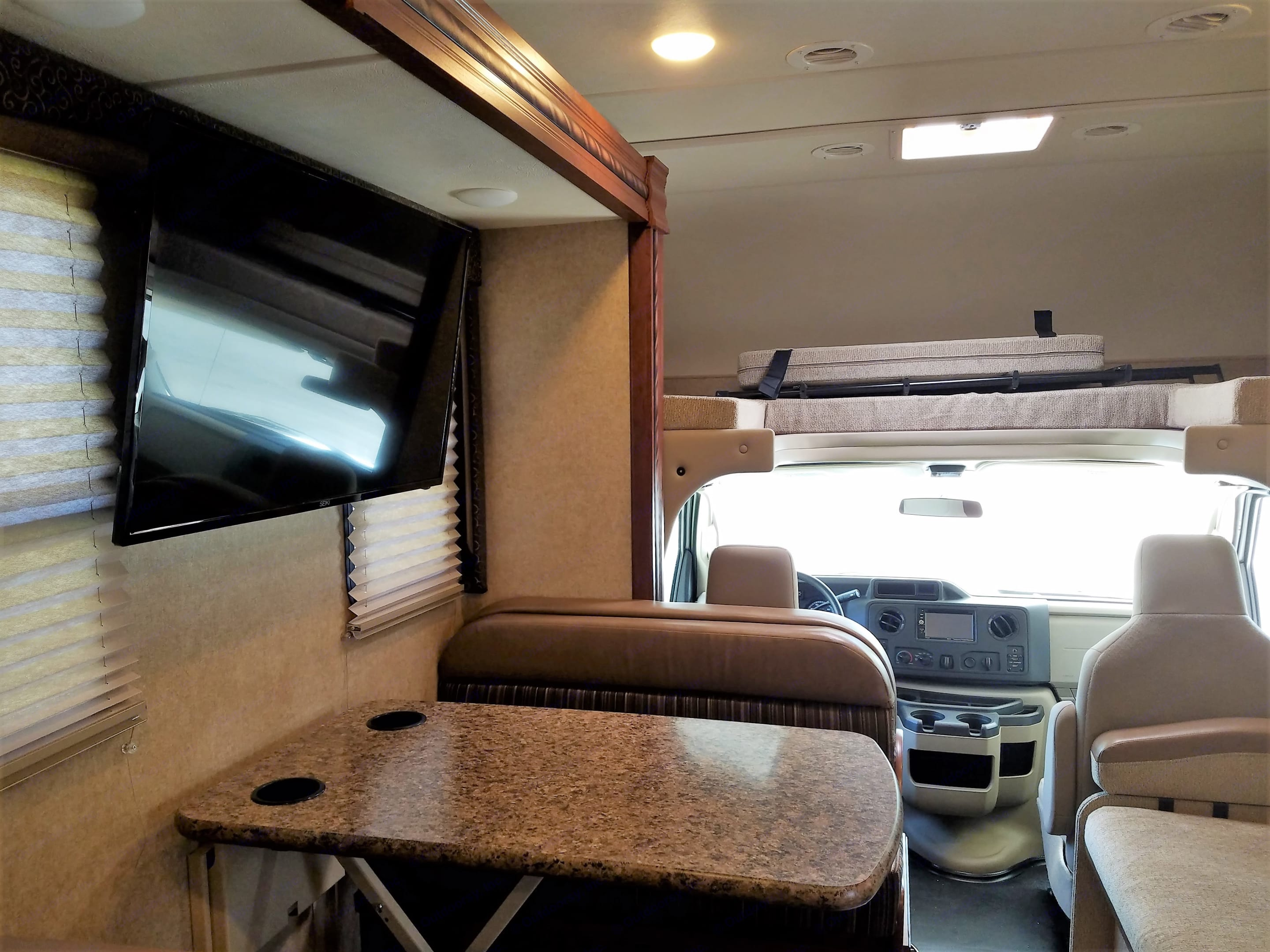 A view of the cab, above cab sleeping area, and dining area, with slide out stored for travel.. Thor Motor Coach Freedom Elite 2016