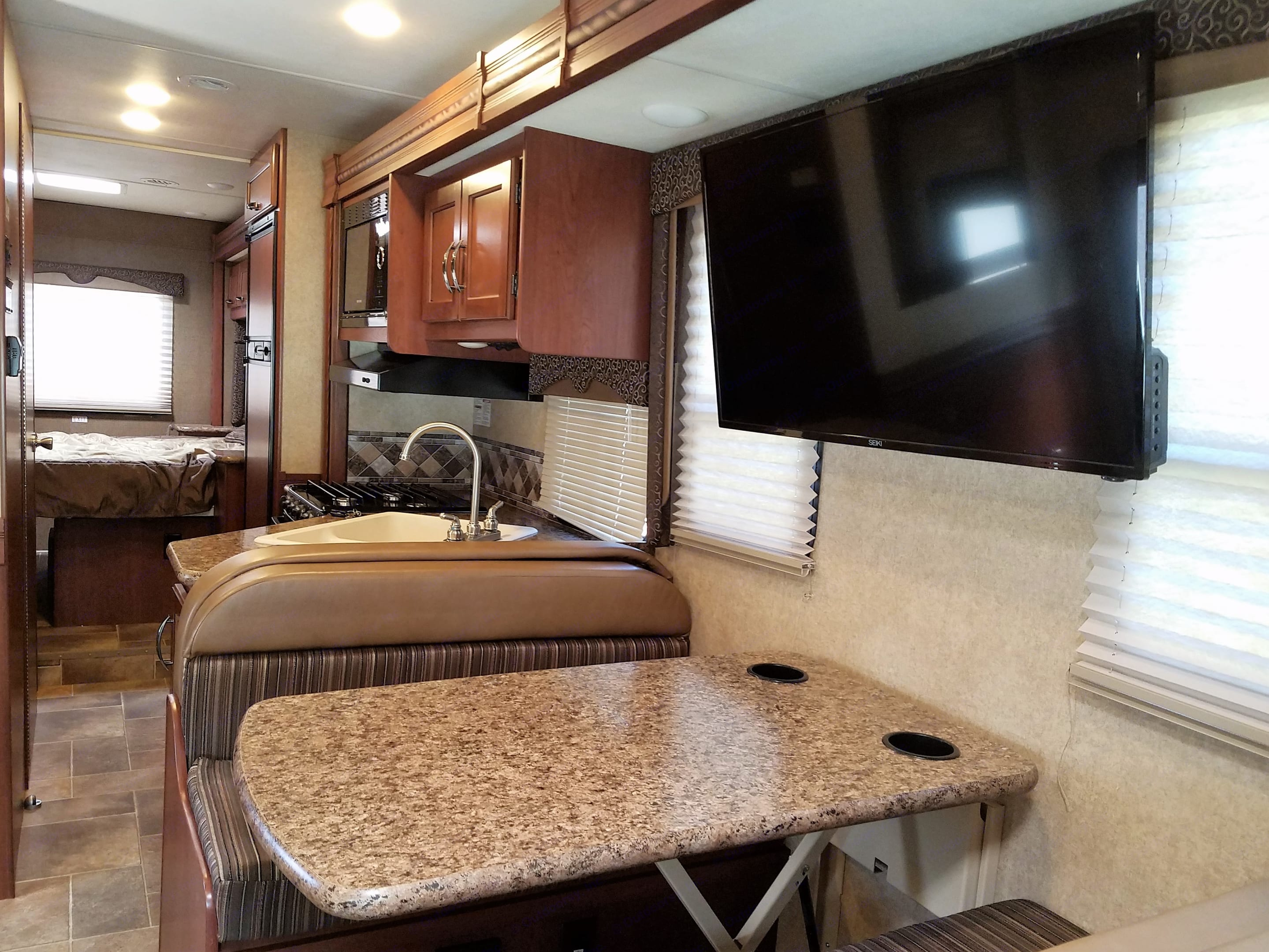 Interior view, looking towards the bedroom, with slide out stored, ready for travel.. Thor Motor Coach Freedom Elite 2016