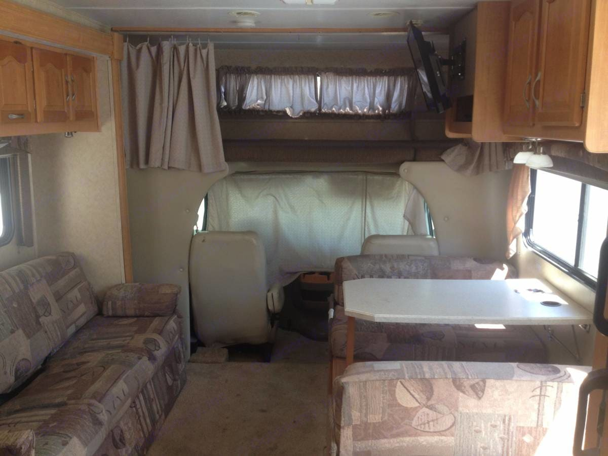 living room area, couch folds out to bed, and dinette table folds out to bed. Forest River Sunseeker 2006