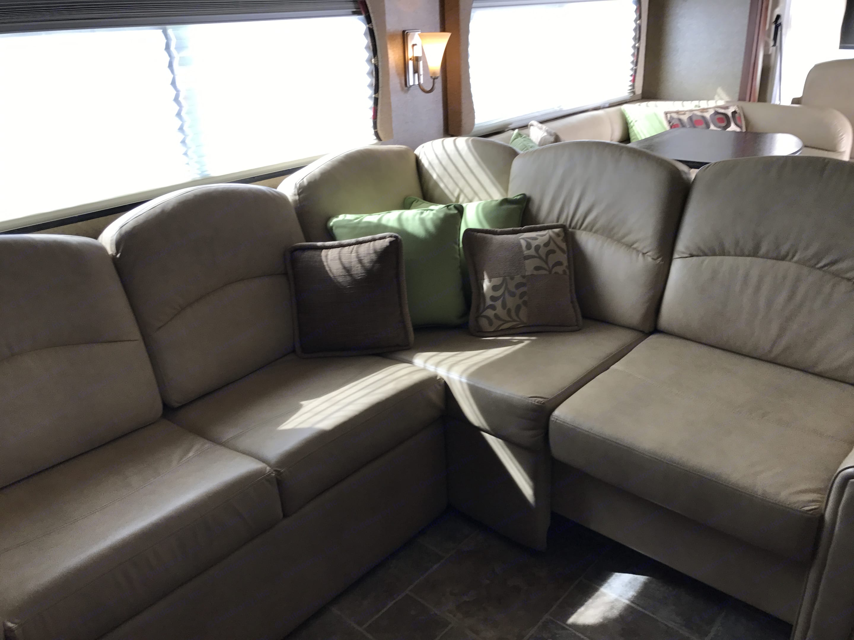 Large  Leather Sectional with Sleeper perfect for daytime entertaining and evening sleeping.. Thor Motor Coach Challenger 2014
