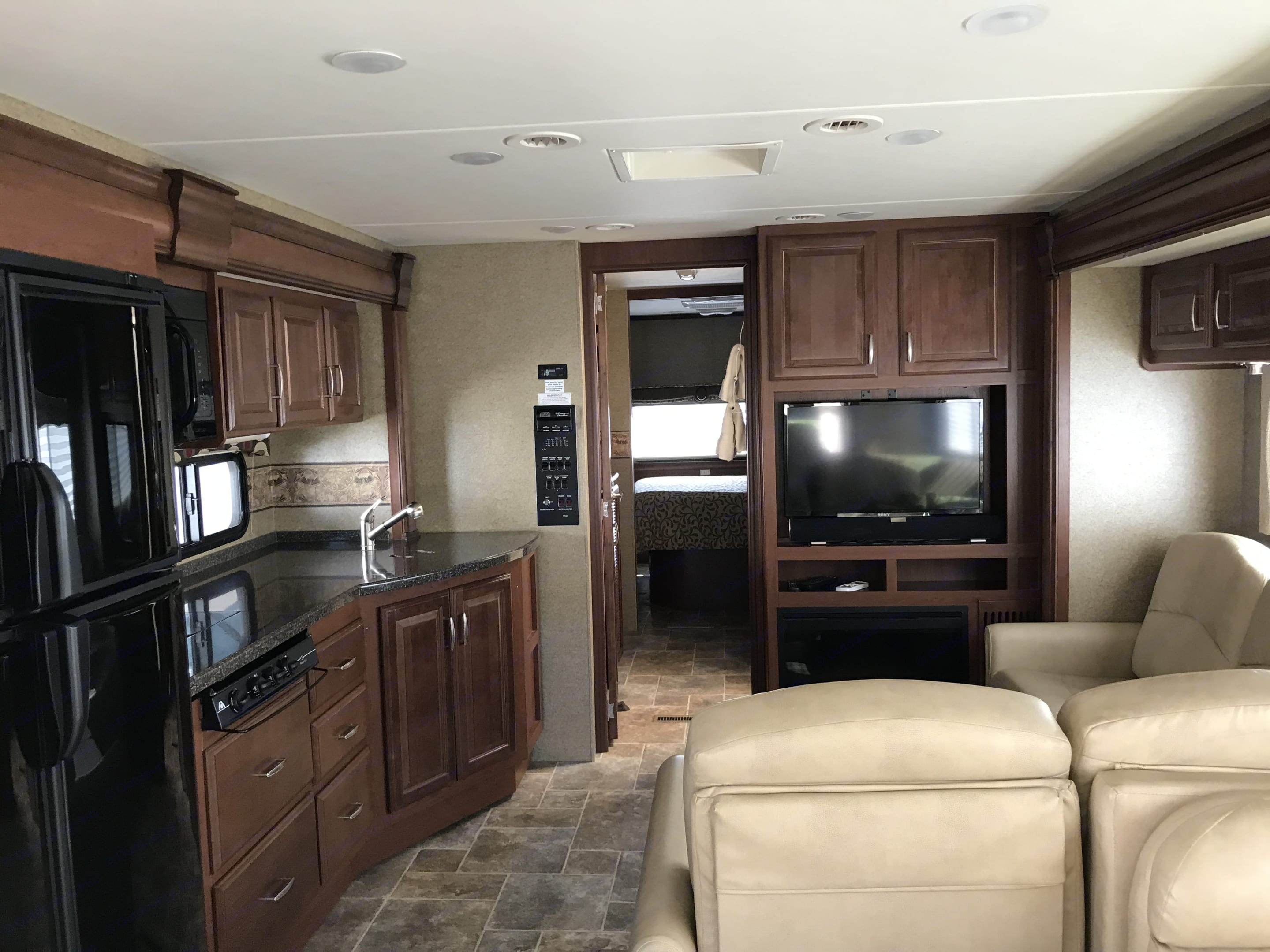 Large Kitchen /Entertainment Area. Fireplace/TV with Sound bar for the perfect Entertainment Big Enough to Entertain and Enjoy. Thor Motor Coach Challenger 2014