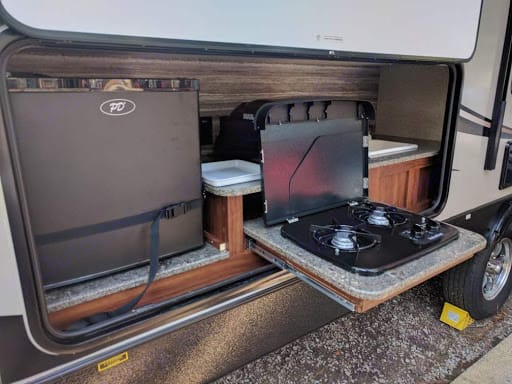 Outdoor kitchen. With refrigerator, Sink, and Stove top. . Heartland Wilderness 2017
