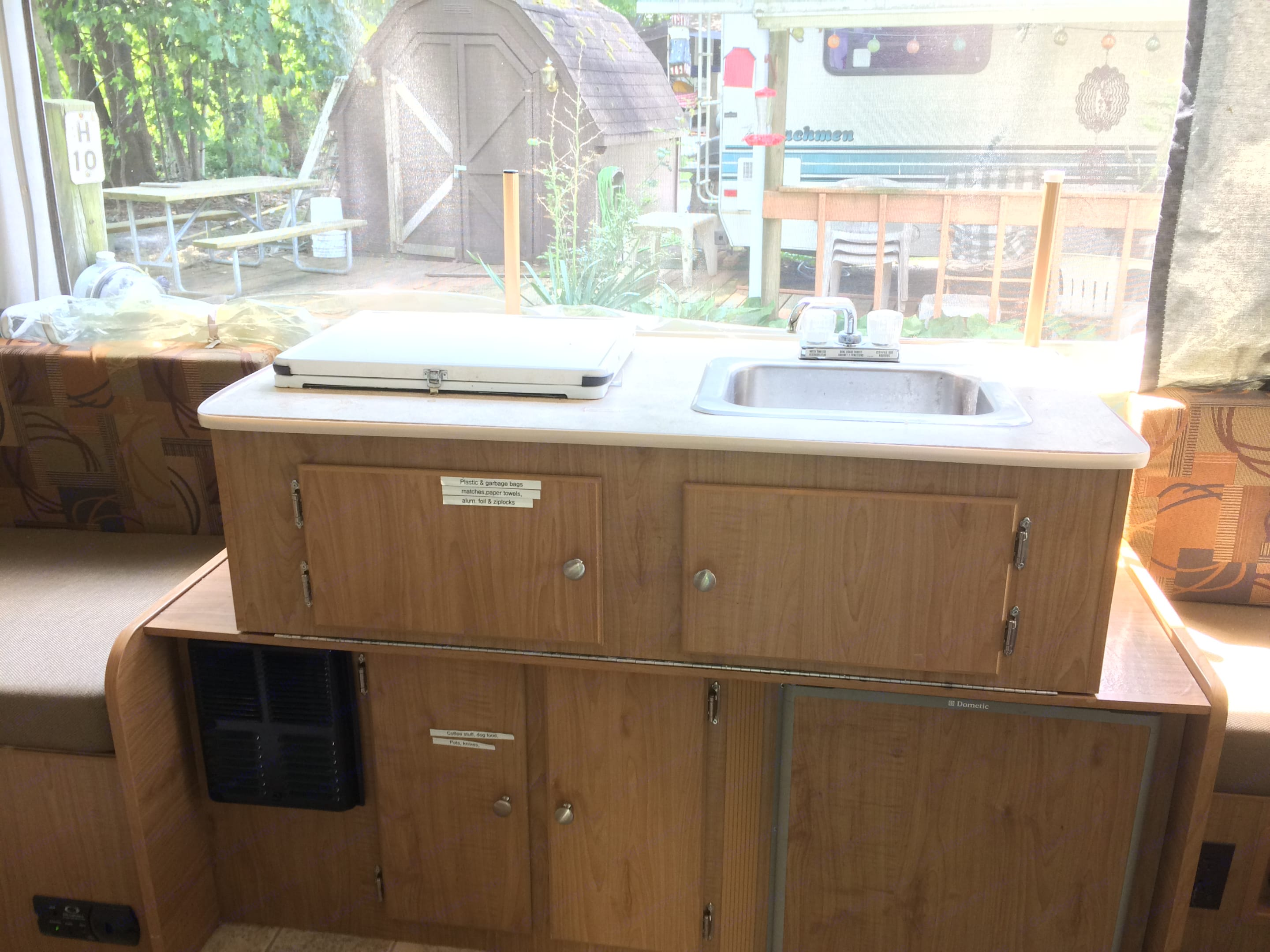 A small, 2 burner propane stove, a small sink and an attachable propane grill outside.. Fleetwood Sea Pine 2007