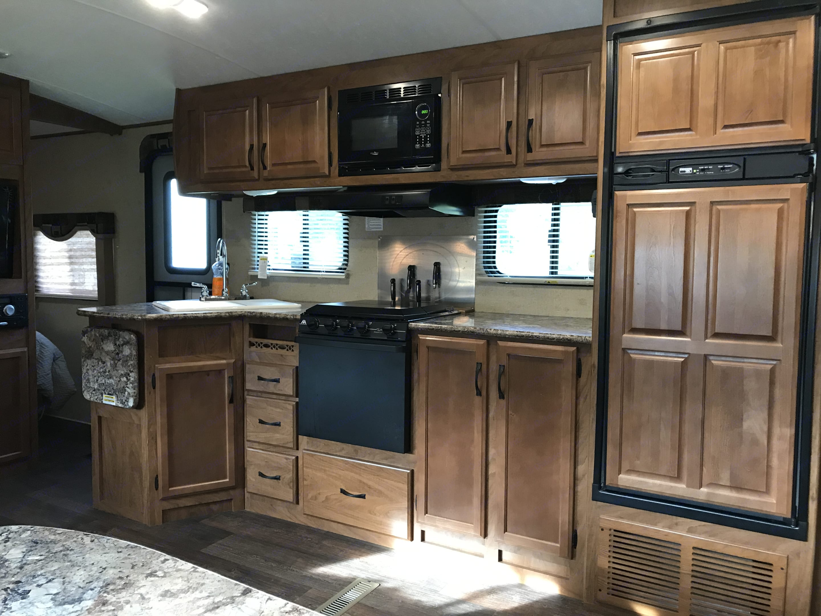 Full kitchen with microwave and oven . Outdoors Rv Manufacturing Creek Side 2015
