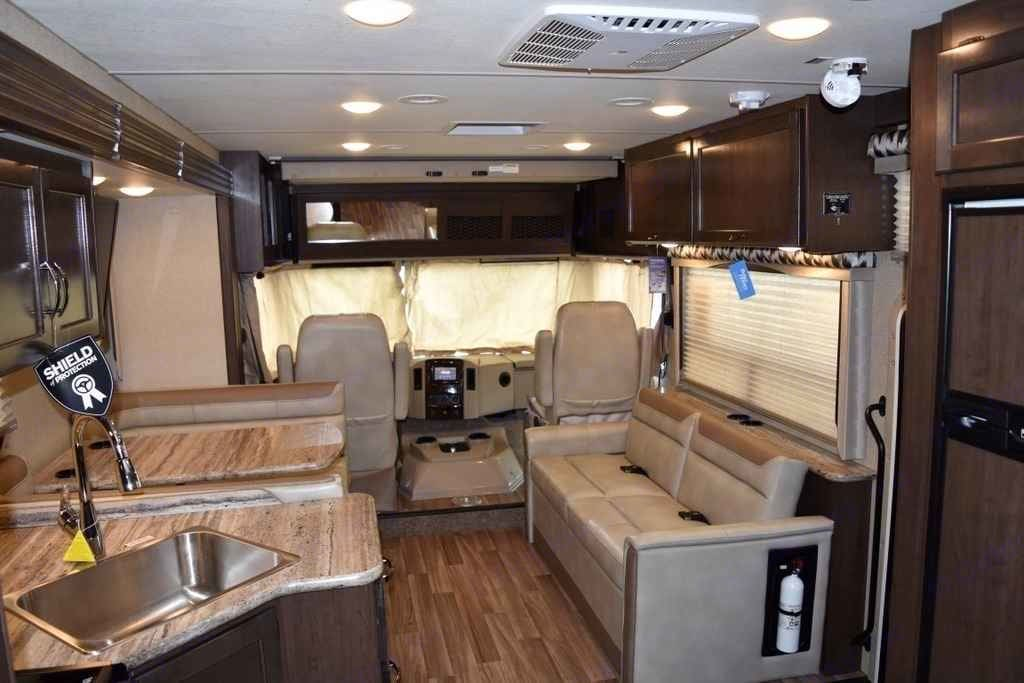 Inside Photo - Sitting Area, Table, part of kitchen Stock Website Photo. Thor Motor Coach A.C.E 2016