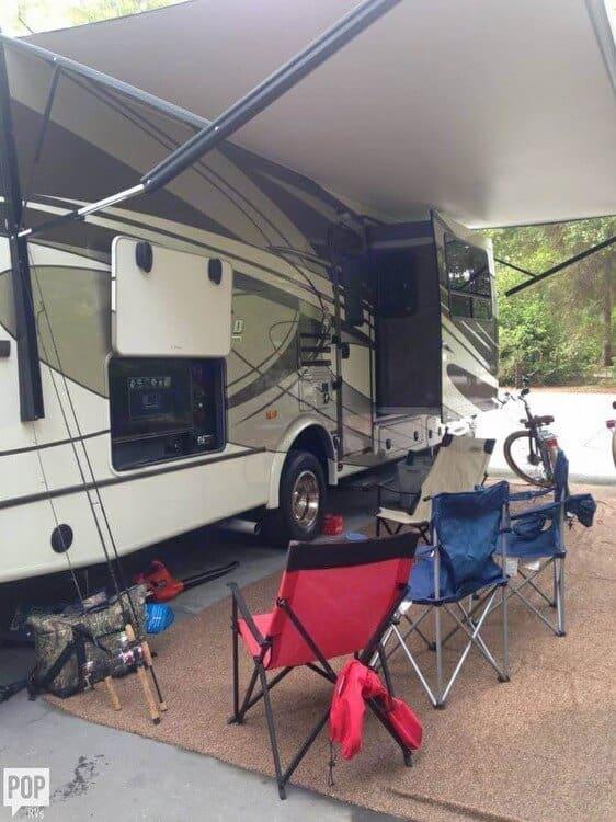 Outdoor entertainment center under spacious awning....and a rug!. Coachmen Concord 2015