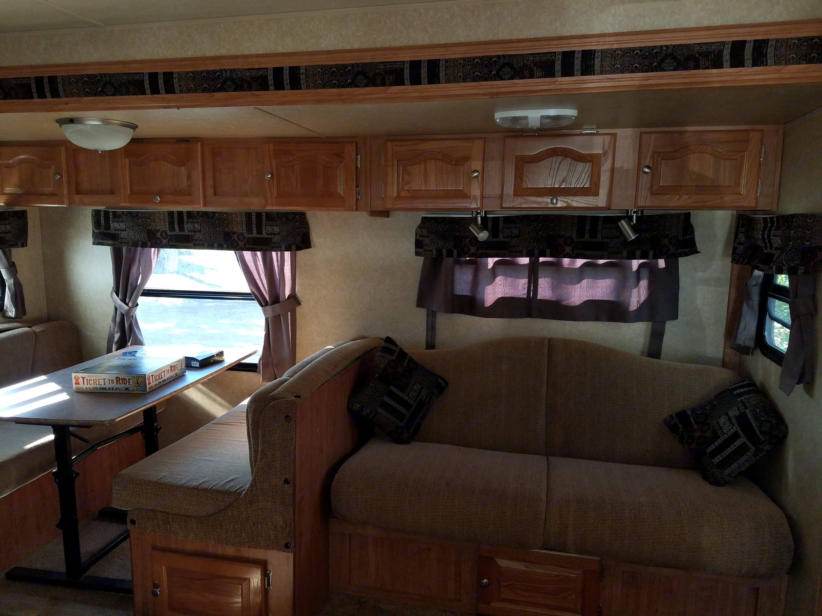 Slide out living area with dining nook, couch and lots of storage.. Forest River Rockwood Roo 2011