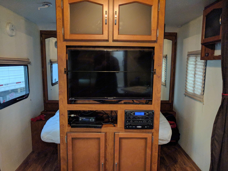 Two flat screen TV's. One on living room side. One on bedroom side.. Keystone Passport 2014