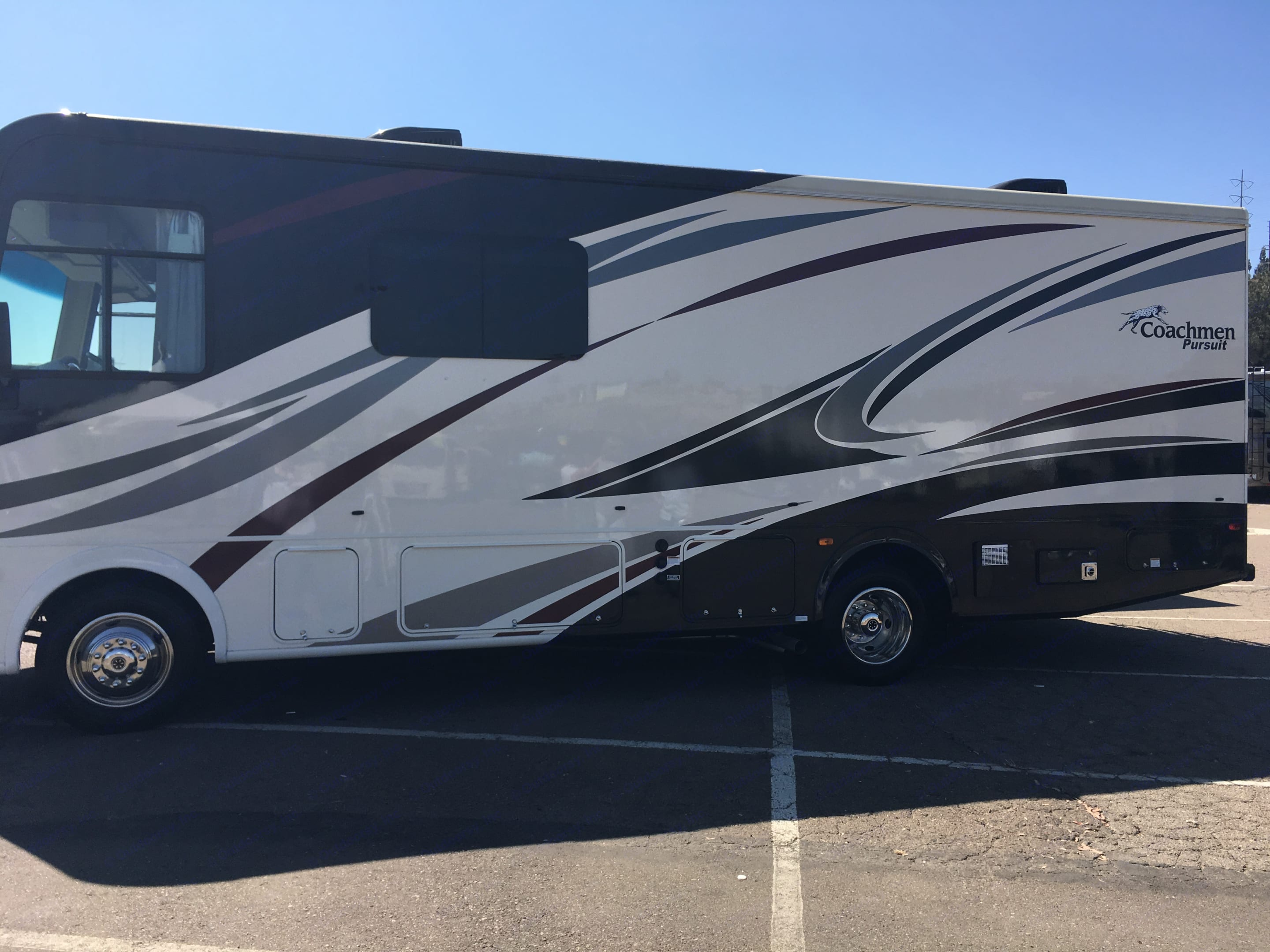 Brand New! Be the first to rent this RV! This coach is easy to drive and park because of its 27 foot length and fantastic visibility.  Feels huge inside with a walk around king bed and tons of storage, mirrored wardrobes and a sliding real solid wood door that locks in the bedroom. This coach feels luxurious in every way. Can be booked fully equipped  for an extra $150 with ever cooking gadget and utensil you could ask for, high thread count sheets, down comforters and designer linens.. Great selection of DVD's and books, stocked with magazines and games to entertain you on board. Great sound system. Watch your movie outdoor while you enjoy your camp fire!. Coachmen Pursuit 2017