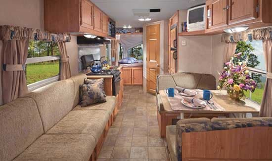 This is a manufacturers photo and represents the interior with full lighting. NOTE! This RV has no TV. You can hook-up your laptop or other device into the stereo system.. Forest River Flagstaff Shamrock 2011