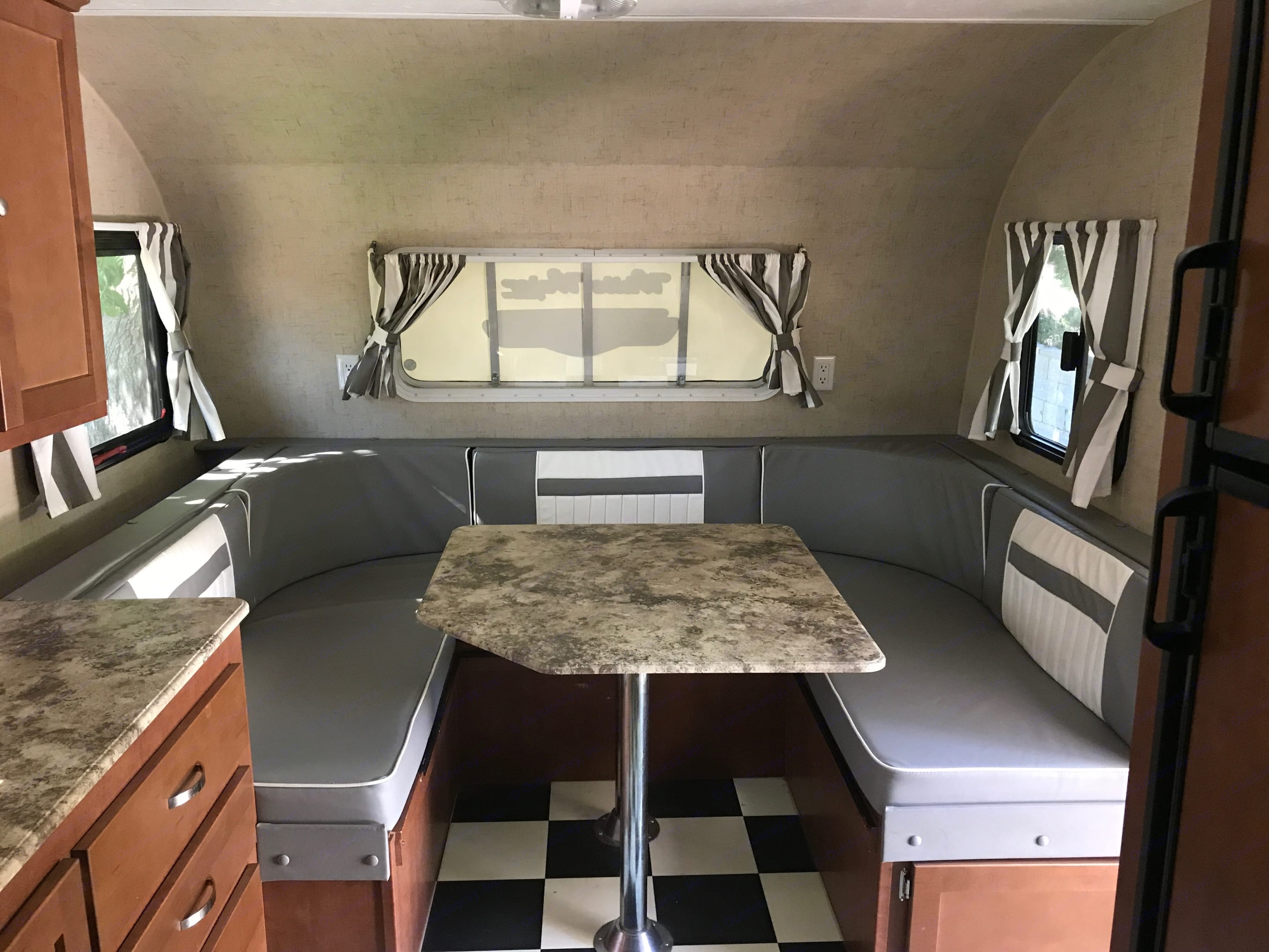 Kitchen table turns into large bed. Riverside Rv Whitewater Retro 181B 2016