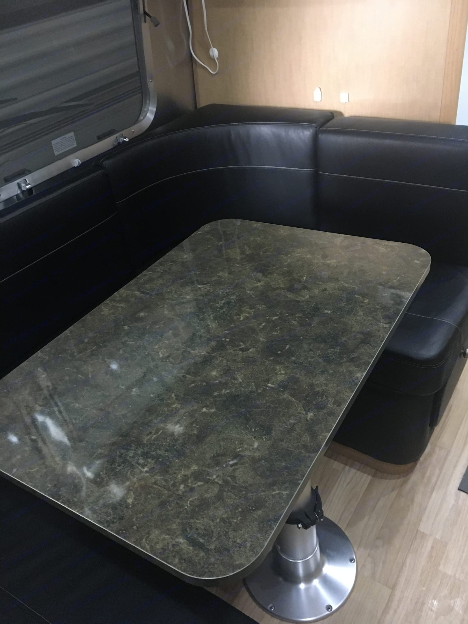 Dinette for the family with super comfy black ultra leather seating.  Very few trailers or RV's are so comfortable!. Airstream Flying Cloud 2016