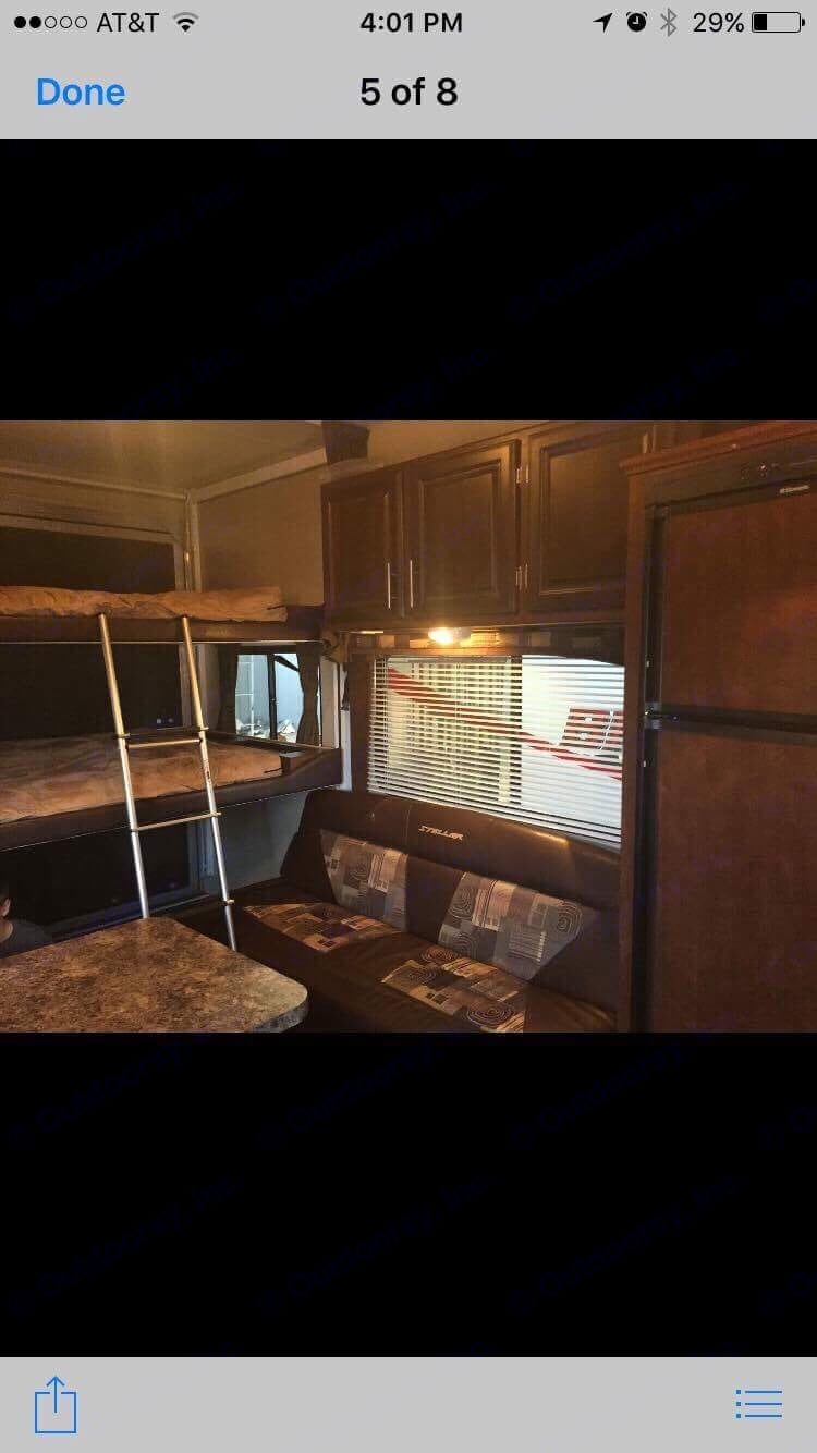 Inside sleeps two queen beds (bunks auto power up or down - very easy to use), couch is one full size couch that reclines to a sleeper.  In addition everything folds up so you can tow and haul items in luxury.. Eclipse Recreational Vehicles Stellar 2014