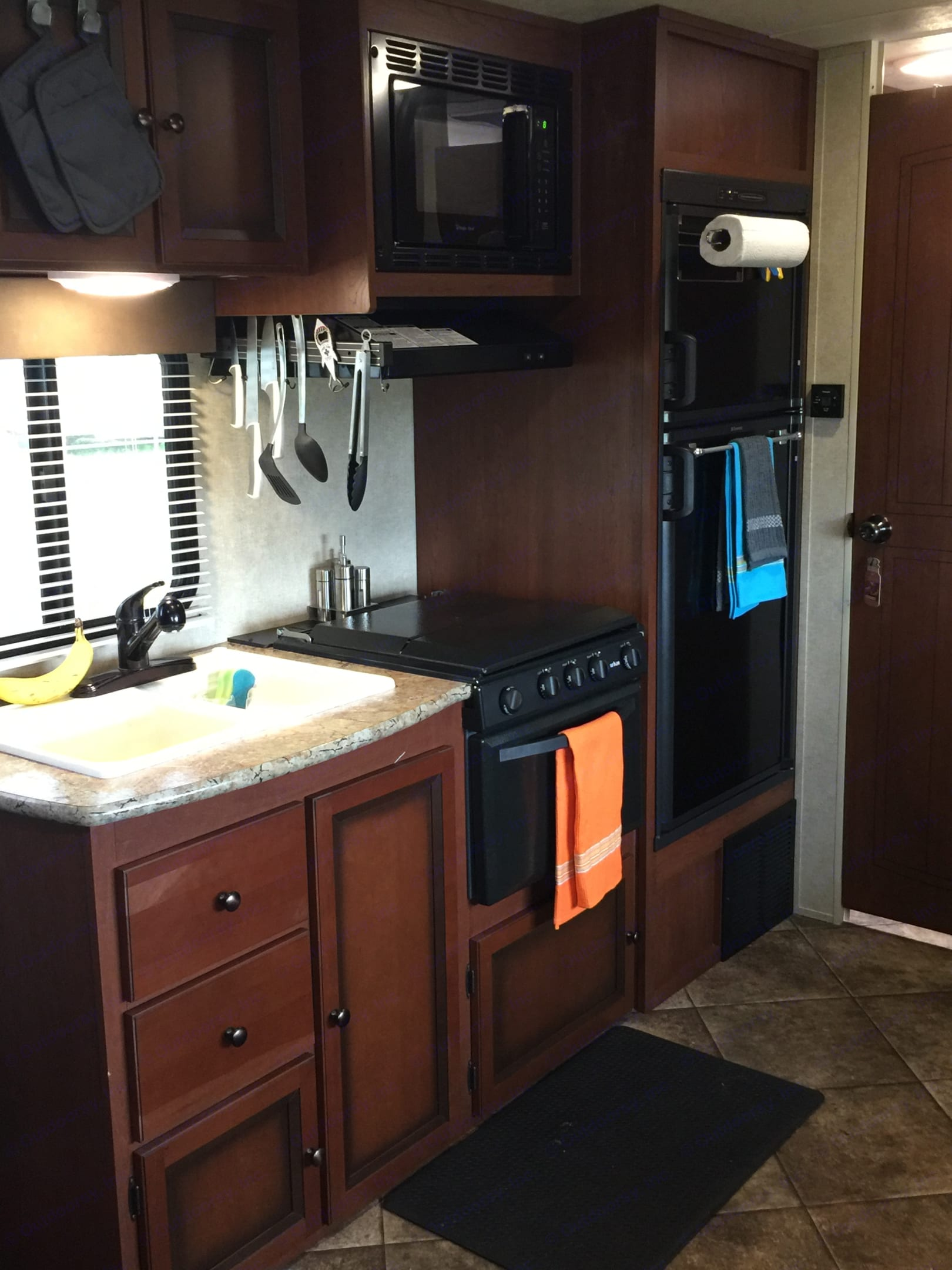 Full kitchen with 3 burners, stove, and microwave.  The fridge has a separate freezer and the sink has a smaller wash area.. Forest River palomino 2014