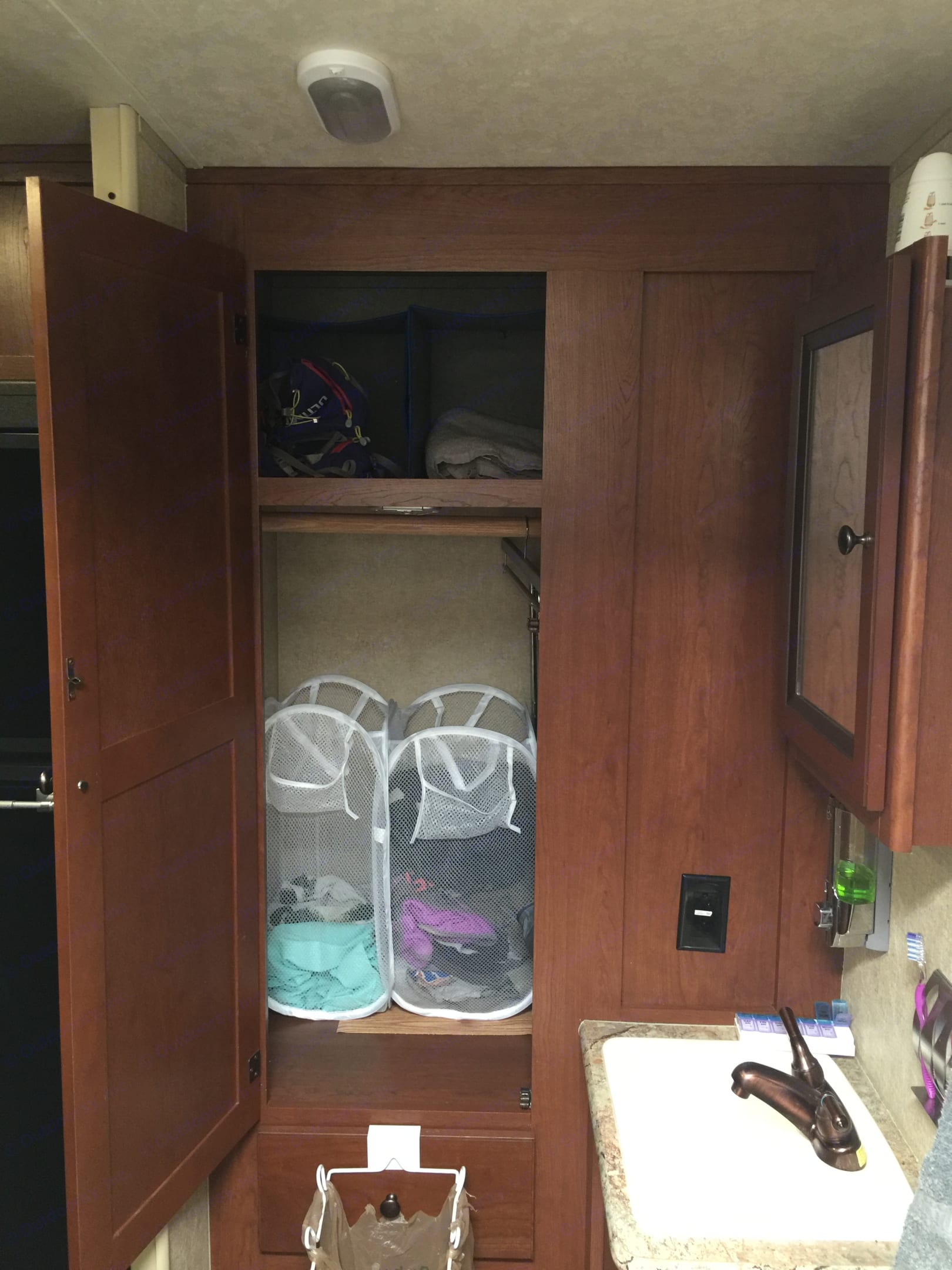 Another large closet with hanging bar in the bathroom, but I simply use it as additional storage.  I've stalled lighting for convenience and as needed.. Forest River palomino 2014